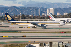 13-569 (George Hamlin) Tags: california los angeles international airport lax singapore airlines airbus a340500 aircraft airliner airplane widebody twin aisle 9vsgd mountains sky skyline building taxiway photo decor photodecor george hamlin photography