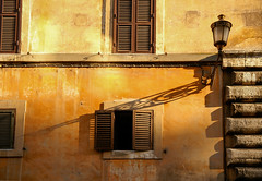 Rome (Greg Adams Photography) Tags: rome wall lamp streetlight travel tourism windows shutters light afternoon shadows texture colors colorful stone stucco hhsc2000 italy europe 2008 golden old