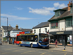 A local bus for 'local' people.......... (Jason 87030) Tags: stagecoach midlands town rugby warks warwickshire local simply shops cliftonroad roadside sunny weather sky clouds publictransport evil twin e200 enviro 36210 buses black people scene uk