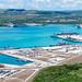 An aerial view of U.S. Naval Base Guam shows U.S., Royal Australian, JMSDF,  and ROK Navies vessels moored