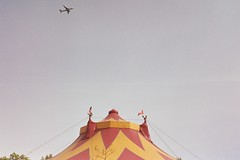 The Big Top (Yutaka Seki) Tags: circus thebigtop entertainment show tent flags airplane kodakcolorplus200 film analogue kodakvr35k12 homedeveloped unicolorpresskit argentixcac41powderkit pakonf135 travellingcircus