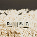 Dice reading DIET over oats