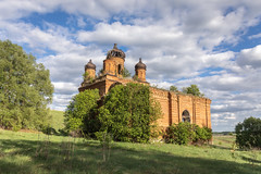 Abandoned Church. (Oleg.A) Tags: grass spring penzaregion russia church nature hill orange clouds summer tree tower orthodox style wall village saintmichaelthearchangelchurch ruined shadow landscape cathedral old brick ancient outdoor rural evening abandoned light building exterior blue colorful dome yellow countryside forest belogorka design panorama skyscape sun architecture sky field