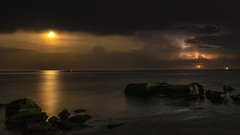 Moon and a little lightning (tonyguest) Tags: moon sea lightning boön månen blixt åska karlshamn sweden tonyguest blekinge nightsky darkclouds reflections