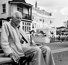 """Welcome to """"Beige World"""". (Neil. Moralee) Tags: neilmoralee old mature senior citizen pension pensioner man portrait street face candid black white bw blackandwhit sidmouth devon uk male grey gray walking stick walkingstick tired exhaustion worn grumpy grandfather pop pops seaside coast older alive health dejected alone lonely lone history hotel view neil moralee olympus omd em5 mono monochrome"""