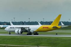 IMGP9475_N775SA_CVG (ClydeSights) Tags: 777fzb airport b77l boeing cvg cincinnatinorthernkentuckyinternationalairport dhlcolours kcvg n775sa southernair cn37987