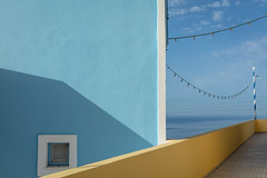 Blue Wall (josullivan.59) Tags: 2019 agean artistic europe greece greek may santorini abstract architecture blue cyclades evening house island islands light lightanddark minimalism ocean sea shadows street texture travel wall wallpaper weather yellow