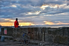 Taking in the sunset (Mr_Pudd) Tags: wheel redsky sky water bollard viewer redcoat red coat fisherow outdoorphotography outdoor sun cloud wall harbour bicycle bike sunset nikond750 nikon