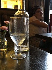 Water glass and roses, dinner at Ambar Capitol Hill, 8th Street SE, Washington, D.C. (Paul McClure DC) Tags: washingtondc districtofcolumbia may2019 restaurant people capitolhill