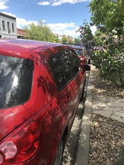 152/365/8 (f l a m i n g o) Tags: car red nissan boulder lilac bush spring bouldercreekfestival project365 365days may 25th 2019 saturday sidewalk parallelpark