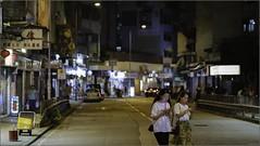 """Distracted"" Sai Ying Pun, Hong Kong, China (May 2019) (Kommie) Tags: sai ying pun hong kong china street photography low light night fujifilm xt3 fujinon 56mm f12 r"