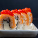 Close-up of sushi with salmon, cheese and red caviar