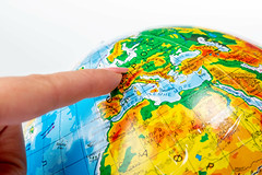 Female finger pointing to Europe on the globe (wuestenigel) Tags: education geography concept ball earth symbol planet background model world map backgrounds global country ocean school travel blue round sphere object environment toy globe international continent