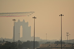 CELEBRATION OF SOMETHING.....NICE TO CATCH THIS PHOTO.  NEAR ABU DHABI. (vermillion$baby) Tags: abudhabi airshow cruiseship arabia architecture buildings cityscape silhoutte skyline sunset uae