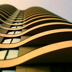 Vertical wavelength (Arni J.M.) Tags: architecture building verticalwavelength balconies curves blur tiltshift windows glass sky london england uk