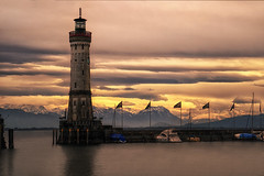 lighthouse of lindau (Robert Stärz) Tags: lindau bodensee lake leuchtturm lighthouse sonnenuntergang sunset sonnenaufgang sunrise wolken clouds berge mountains boot boote spiegelung reflection seascape cielo dusk lakeconstance badenwürttemberg landscapephoto fineartlandscape travelphotography fineartphotography nature flickr national