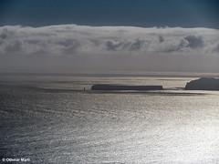 Silhouette of the Ilhéu Chão (OthmarMarti) Tags: camacha dmcg6 lumixgvario14140mmf3556 lumix14140mm madeira prt panasonic portugal geo:lat=3267879236 geo:lon=1684432728 geotagged madeiraisland island ilhéuchão atlantic ilhasdesertas reflection silhouette