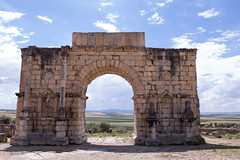 Volubilis Triumphal Arch (Irina1010) Tags: volubilis archaeologicalsite triumphalarch landscape sky fields beautiful romanempire unesco history city morocco 2019 canon
