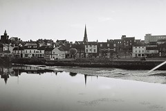 Town reflected (bigalid) Tags: film 35mm olympus az300 superzoom ilford xp2 c41 bw may 2019 river nith