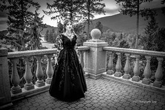 Game of Thrones  (Actual model and surroundings) (Christie : Colour & Light Collection) Tags: witch medieval gameofthrones elegant formal portrait castle roman empire renaissance romanempire queen princess sorceress enchantress ruler darkages blackandwhite monochrome mono pillars columns enchanted lordoftherings formalgown beautiful magical powerful kingsandqueens blackmagic vampire bw onceuponatime balcony cobblestone trees mood karma goth presence nikkor nikon fairytale storybook blacklace