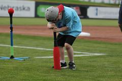 "Tiny child winning the ""Tornado Tee-Off"" (Minda Haas Kuhlmann) Tags: sports baseball milb minorleaguebaseball pacificcoastleague omahastormchasers nebraska omaha papillion sarpycounty outdoors fans onfieldpromotions tinyadorablehumans"