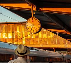 Sunset in Munich Hauptbahnhof (christos.tsiapalis) Tags: 365 project365 sunset munich münchen hauptbahnhof zug clock hat trainstation fedora