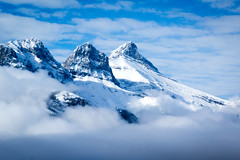 Out of the Clouds (ellieupson) Tags: threesisters canmore alberta canada nationalpark banff mountain sky snow clouds mist blue white winter