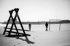 Monuments of Separation (Adam Bonn) Tags: 7artisans 7artisans50mmf11 beach beachlife humanistic streetphotography life leica leicam9 leicam m9p m9 blackandwhite blackwhite monochrome 50mm shadows coast couple