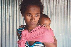 When Tomorrow Comes (u c c r o w) Tags: mother mom mum child baby africa ethiopia ethiopian portrait woman girl pink sad eyes african metema portre worried