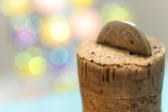 """Superstition - """"Good luck cork"""" (Barrie T) Tags: macromonday cork champagne lansonblacklabel 20p coin silver goodluck bouyancy lightroom superstition bokeh macro"""