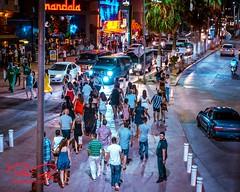 _NIK3167-8x10signdotcom (RoManLeNs) Tags: streetphotography street life nightlife lowlight city outdoors walking streetwalking crowds people men women romanlens