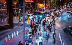 _NIK3165-16x10signdotcom (RoManLeNs) Tags: streetphotography street life nightlife lowlight city outdoors walking streetwalking crowds people men women