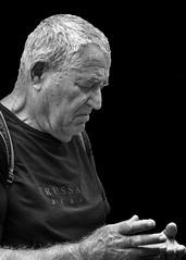Portrait (D80_536122) (Itzick) Tags: denmark copenhagen candid bw blackbackground bwportrait man cellphone face facialexpression streetphotography whitehair portrait d800 itzick