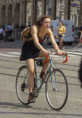 in a hurry (Henk Overbeeke Atelier54) Tags: girl candid street bike bicycle bicicletta fiets fahrrad vélo racing minidress earphone amsterdam