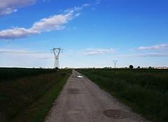 Strada di campagna (Aellevì) Tags: pianura traliccio pozzanghera