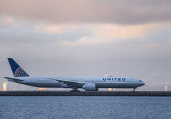 united flight ua 901 taxis for takeoff to london (pbo31) Tags: bayarea california nikon d810 color may 2019 boury pbo31 memorialday holiday sanfranciscointernational sfo airport aviation plane travel burlingame airline flight sunset sky sanmateocounty boeing 777 united taxi departure