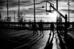 who knows where the time goes? (fallsroad) Tags: gatheringplace tulsaoklahoma park court basketball men people street sun sunset goldenhour game play shadows ball riversidepark arkansasriver candid blackandwhite bw monochrome