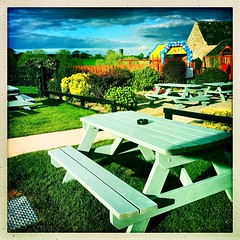 Beer Garden Benches (Julie (thanks for 9 million views)) Tags: 100xthe2019edition 100x2019 image60100 hipstamaticapp iphonese vinecottage pub beergarden bench hbm fence colourful squareformat ireland irish publichouse clouds grass