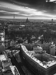 Riga Cityscape (Wormsmeat) Tags: riga latvia towers urban cityscape metropolis sunrays sky clouds olympus 12100mzuikopro penf