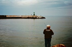 Il pescatore (michele.palombi) Tags: versilia viareggio analogic shot 35mm kodak ektar100 colortec c41 negativo colore riflessi tuscany
