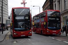 Go-Ahead London MHV15 on Route 176 & Metroline VMH2533 on Route 134, Tottenham Court Road (e400olympus) Tags: goahead london mhv15 bu16oyz metroline vmh2533 lf68pxk volvo b5lh hybrid mcv evoseti