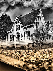 (Scorpiol13) Tags: trees plants picketfence fence wood residence landscape pavement sidewalk dramatic shadows lightandshadow snapseededit mobiography iphoneography blackandwhite sepia duochrome monochrome clouds hdr exterior rocks stones stonewall house