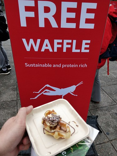 Free waffles, sustainable and protein-rich, from The Economist magazine with roasted crickets outside Freshwater Place, Melbourne
