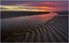 Sunset at Maasvlakte beach (Rob Schop) Tags: sunset red clouds burningsky beach composition wideangle samyang12mmf20 pola bracket leadinglines sonya6000 f11 reflection seascape maasvlakte zuidholland tide whywedoit