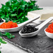 Food background with black and red caviar, butter and parsley