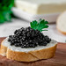 Sandwich with butter and caviar close-up