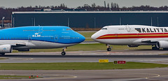 Queens of the sky having a good old chinwag... (Aleem Yousaf) Tags: kalitta klm boeing 747 jumbo jet schiphol plane spotting taxi crossing chinwag prime 300mm teleconverter chat amsterdam noord north panorama terrace queen sky cargo royal dutch airlines city johannesburg