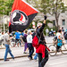 Protester holding a waving ANTIFA flag