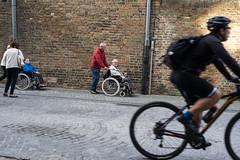 Wheels (rj.putter) Tags: bruges brugge belgium streetphotography street wheels bike biker wheelchair
