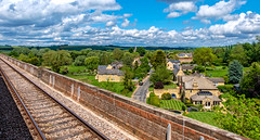 Harringworth (Peter Leigh50) Tags: harringworth viaduct welland valley village church building house countryside cottage landscape sky clouds road fujifilm fuji xt2 train trees track line car railway railroad rail rural sunshine shadows
